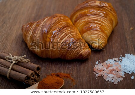 fresh baked french croissant brioche on wood board stock photo © keko64