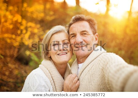old couple in a park at autumn season Stock photo © photography33