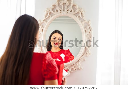 Surprised woman reflected in a mirror Stock photo © photography33