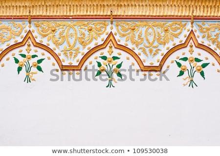 floral thai art on temple door stock photo © pinkblue