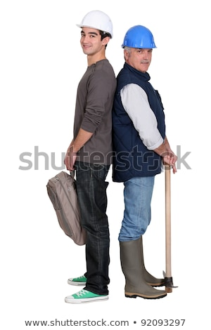 senior craftsman and young apprentice standing back to back Stock photo © photography33