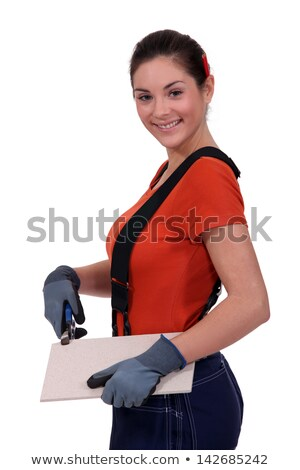 Tradeswoman holding a tile Stock photo © photography33