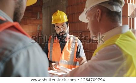 Kőműves magyaráz építkezés munka szerszámok póló Stock fotó © photography33