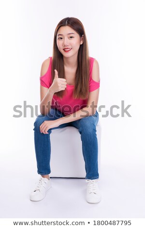 Good looking woman posing while standing up against a white background Stock photo © wavebreak_media