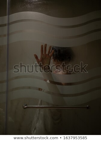 Hands silhouettes touching blurry glass screaming for help Stock photo © photocreo
