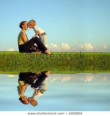 mother with son on sundown kiss by nose. long. water Stock photo © Paha_L