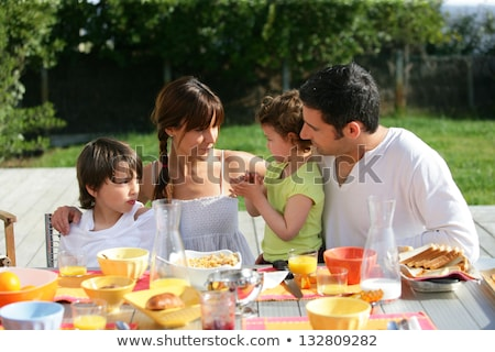 Family having brunch outside on a sunny day Stock photo © photography33