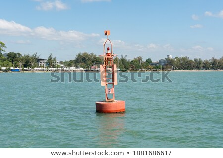 Beacon floating on blue ocean as guide help Stock photo © lunamarina