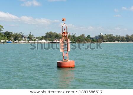 beacon floating on blue ocean as guide help stock photo © lunamarina