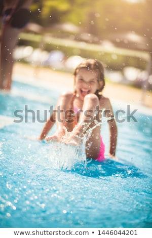 child has fun in the pool  Stock photo © meinzahn