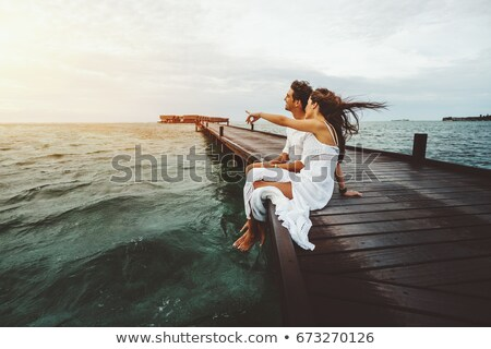 Laughing young couple during the honeymoon Stock photo © konradbak