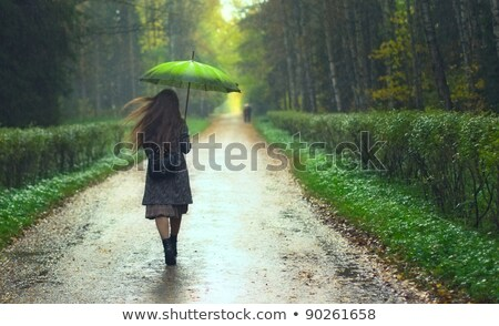 woman with red umbrella walking away stock photo © stevanovicigor