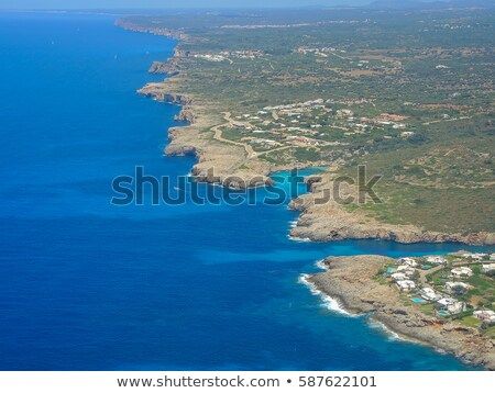 Menorca island coastline viewed from plane, Spain. Stock photo © tuulijumala