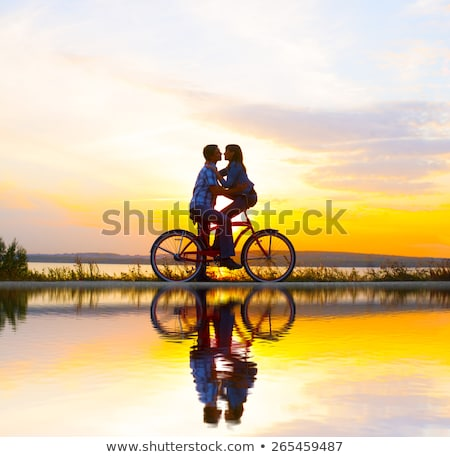 the girl and the man with bicycles embrace each other stock photo © paha_l