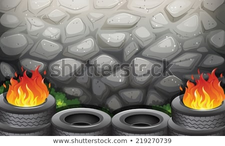 Burning tires near the stonewall Stock photo © bluering