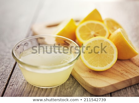 lemon juice and fresh lemons stock photo © digifoodstock