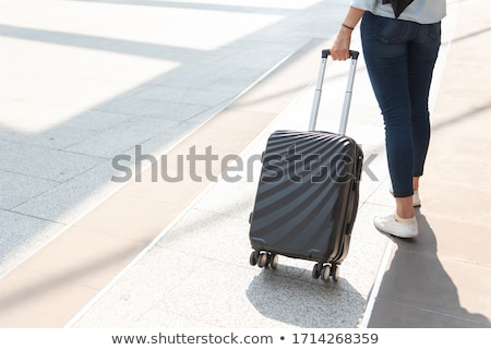 Tourist with Trolley Suitcase Stock photo © robuart