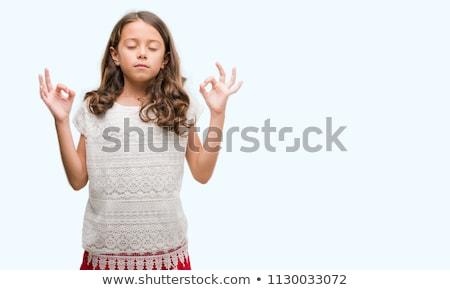 calm brunette doing yoga stock photo © wavebreak_media