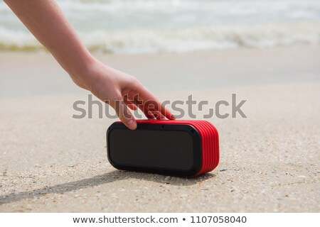 Portable radio on the sand Stock photo © IS2