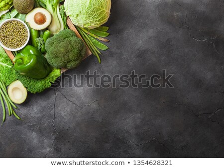 Assorted green toned raw organic vegetables on dark background. Avocado, cabbage, cauliflower and cu Stock photo © DenisMArt