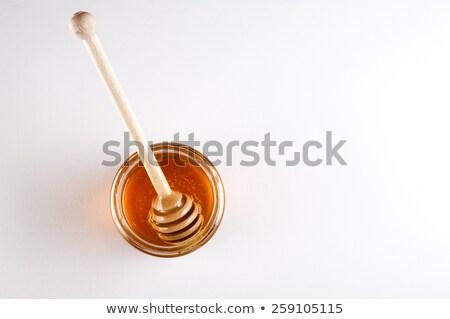 Primer plano vista vidrio jar dorado miel Foto stock © artjazz