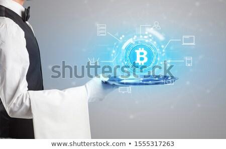 Waiter serving cryptocurrency concept Stock photo © ra2studio