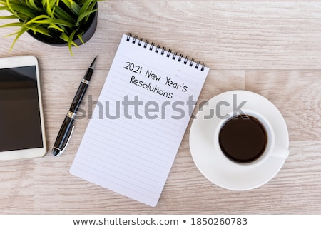 text new years goals in a cup of coffee Stock photo © nito