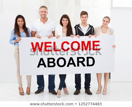 Group Of People Holding Welcome Aboard Placard Stock photo © AndreyPopov