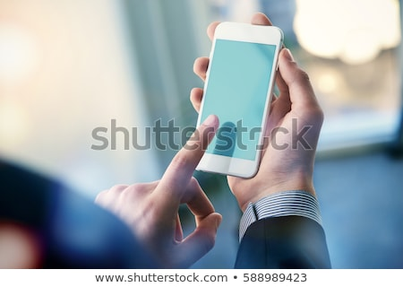 Mock up of a man holding device and touching screen. Clipping path Stock photo © ruslanshramko