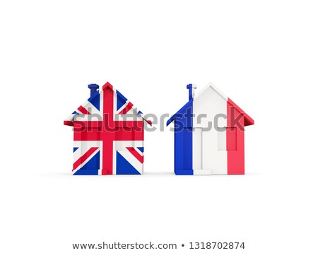 Two houses with flags of United Kingdom and france Stock photo © MikhailMishchenko