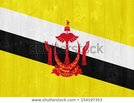 Brunei flag on wooden board Stock photo © colematt