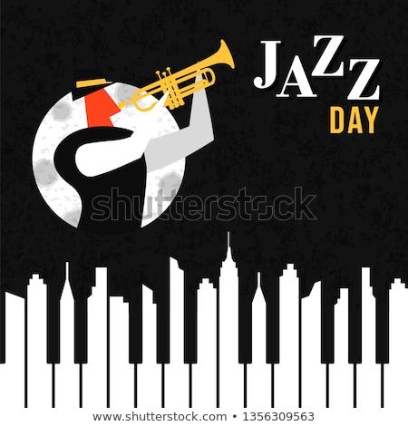 Jazz Day poster of piano keys as city skyline Stock photo © cienpies