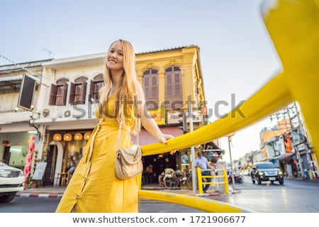Woman tourist on the Street in the Portugese style Romani in Phuket Town. Also called Chinatown or t Stock photo © galitskaya