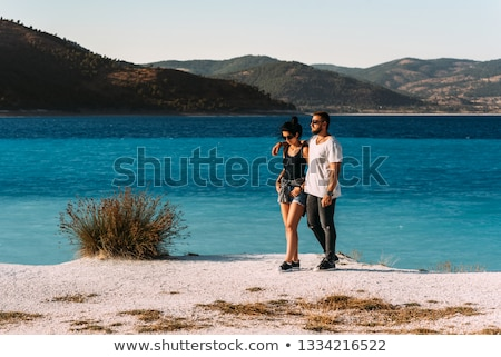 Beautiful young woman traveling along Mediterranean sea on sail  Stock photo © boggy