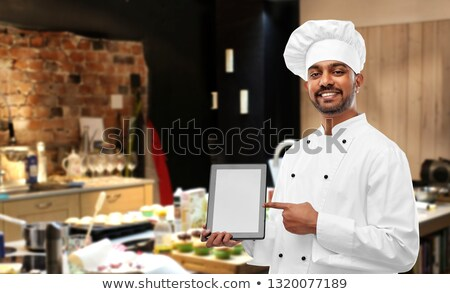 happy indian chef with tablet computer at kitchen Stock photo © dolgachov
