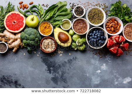 Beans and nuts selection in bowls. Healthy food Stock photo © Illia