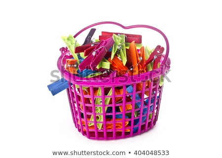 yellow basket with clothes pegs stock photo © hofmeester