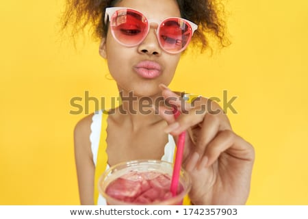 African american woman drinking cocktail in sun Stock photo © darrinhenry