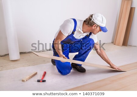 Workman installing laminate floor Stock photo © photography33