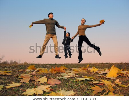 fly happy family with autumn leaves. color sunset sky Stock photo © Paha_L