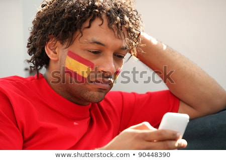 Spanish football supporter with mobile telephone Stock photo © photography33