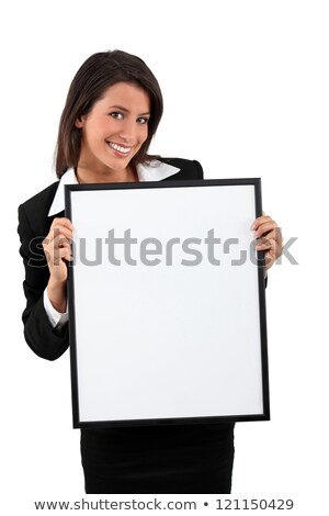 smart young woman holding a blank board ready for your text stock photo © photography33