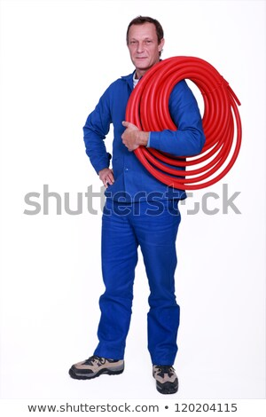 tradesman holding coiled tubing around his shoulder stock photo © photography33