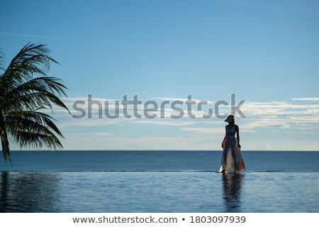 Woman walking along an infinity pool Stock photo © photography33