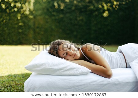 Stock photo: Young girl sleeping on the grass