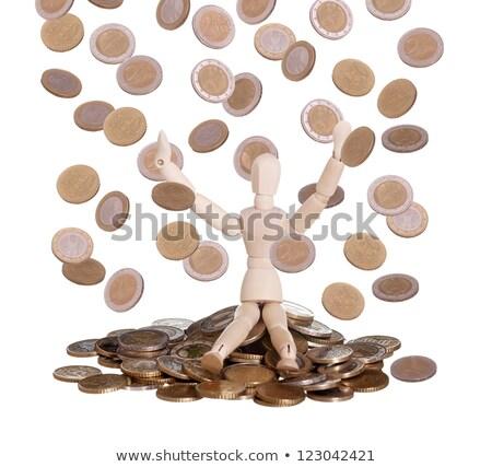 Wooden Doll In Rain Of Euros Stock fotó © pterwort