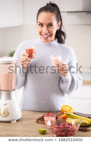 фрукты пить девушки пластиковых Кубок Сток-фото © ElinaManninen