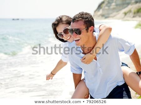 szczęśliwy · lata · plaży · młodych - zdjęcia stock © dotshock