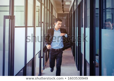 businessman in a hurry looking at his watch Stock photo © photography33