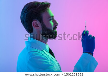 Confident surgeon holding a syringe  Stock photo © Andersonrise
